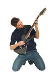 Man playing guitar in knees Royalty Free Stock Photo