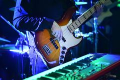 Man  hand playing guitar at music concert during night royalty free stock photography