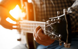A man is playing on guitar. Musician playing electric guitar, close up Stock Photos