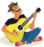 Man playing guitar. Musician sitting cross-legged, playing guitar and singing, EPS 8 vector illustration Royalty Free Stock Images