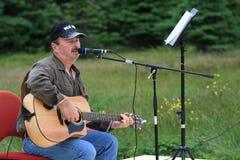 Man Playing Guitar Outdoors Stock Images