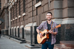 Man playing on the guitar outdoors Stock Photography