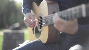 Man Playing Guitar Outdoors stock video