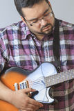 Man playing guitar Stock Photography