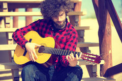 Man playing guitar Stock Images