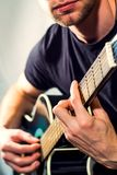 Man playing on the guitar, picture with a light toning Royalty Free Stock Image