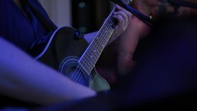 Man playing the guitar,practicing in playing guitar, handsome young men playing guitar,man playing the guitar. stock video footage