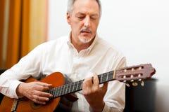 Man playing guitar Stock Image