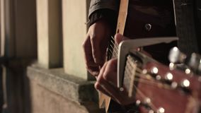 Man Playing Guitar At The Street stock footage