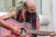 Man playing guitar on the street Stock Photo