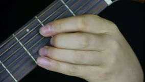Man playing guitar,strum. stock footage