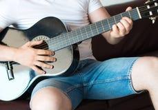 Man playing guitar. Unrecognizable man playing guitar at home Stock Photos