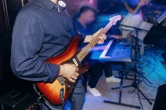 Man playing guitar at wedding party . musician band live perform stock image