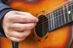Man playing guitar. In winter day Stock Photo