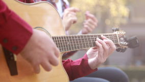 Man playing guitar while woman snapping fingers stock video