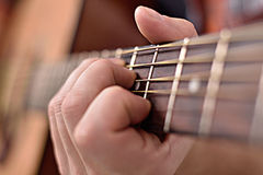 Man Playing Guitar. Man Playing On A Yellow Classical Guitar, Extra Close Up Royalty Free Stock Photography
