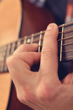 Man Playing Guitar. Man Playing On A Yellow Classical Guitar, Extra Close Up Royalty Free Stock Photo