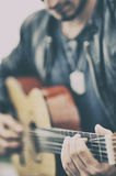 Man playing a guitar. Young man playing a guitar Royalty Free Stock Images