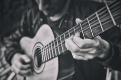 Man playing a guitar Stock Image