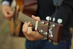 Man playing guitar. Young man playing classic guitar royalty free stock photos