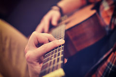 Man Playing On Guitar. Young Man Playing On A Yellow Classical Guitar, Close Up Stock Images