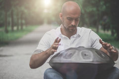 Man Playing Hang Drum Sitting N The Park Stock Photo