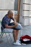 Man playing hang instrument royalty free stock photo