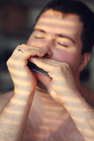 Man playing on harmonica Royalty Free Stock Photo