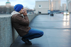 Man playing harmonica. On the street Stock Photos