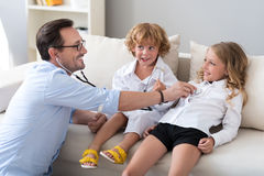 Man playing with his children Royalty Free Stock Photo