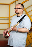 Man playing his cigar box guitar Royalty Free Stock Photos