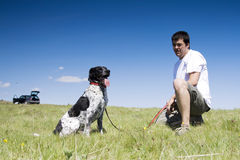 Man playing with his dog Royalty Free Stock Images