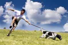 Man playing with his dog Royalty Free Stock Photo