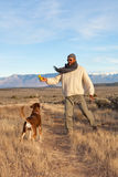 Man playing with his dog. Active African American man playing with his dog outdoors Royalty Free Stock Photos