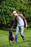Man playing with his dog Stock Photography