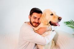 Man playing with his dog. A portrait of a man playing with his dog royalty free stock image