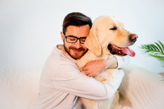 Man playing with his dog. A portrait of a man playing with his dog stock photo