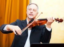 Man playing his violin Stock Photo