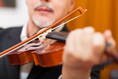 Man playing his violin Royalty Free Stock Photo