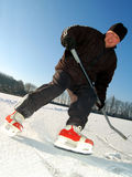 Man playing hockey. On frozen pond Royalty Free Stock Images