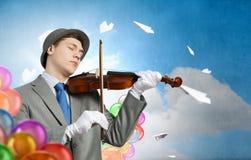 Man playing holiday melody Royalty Free Stock Photography