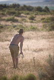 Man Playing Horseshoes Stock Image