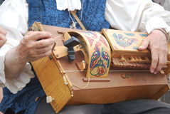 Man playing hurdy gurdy Royalty Free Stock Images