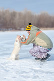 Man playing with a husky puppy Royalty Free Stock Image