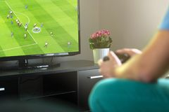 Man playing imaginary soccer or football console game on tv. Man playing imaginary soccer or football console game on tv at home. Holding gamepad in hand. Fun Stock Photos