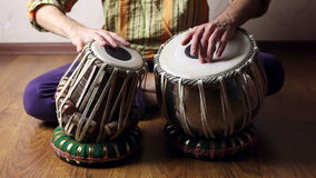 Man playing on Indian tabla drums stock video