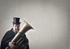 Man playing instrument Stock Photography