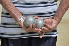 Man playing jeu de boules Stock Photo