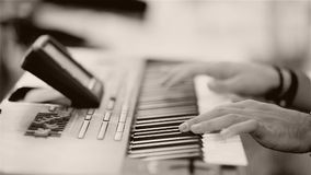 Man playing a keyboard instrument. A keyboard instrument is a musical instrument played using a keyboard, a row of levers which are pressed by the fingers. The