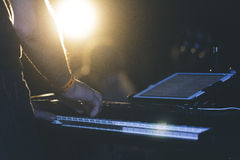 Man Playing a Keyboard With a Tablet Attached on a Stage Stock Images
